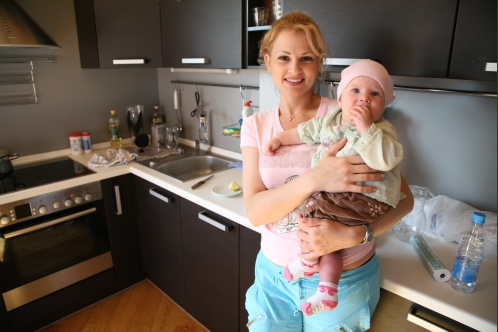 mother with baby on the kitchen