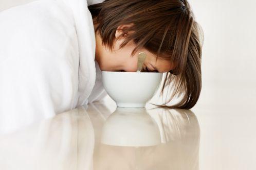 Lazy female fallen asleep in the breakfast bowl