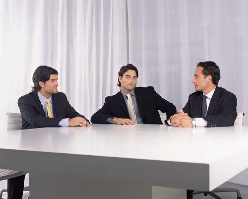 Three businessmen talking