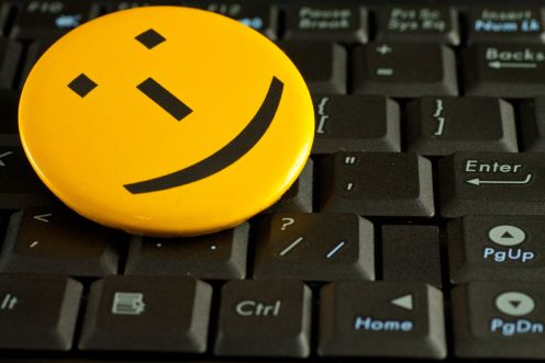Smile emoticon on the laptop keyboard